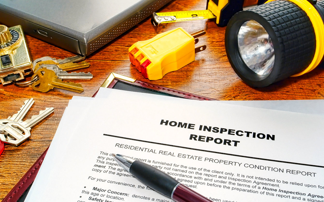photo of home inspection report paper