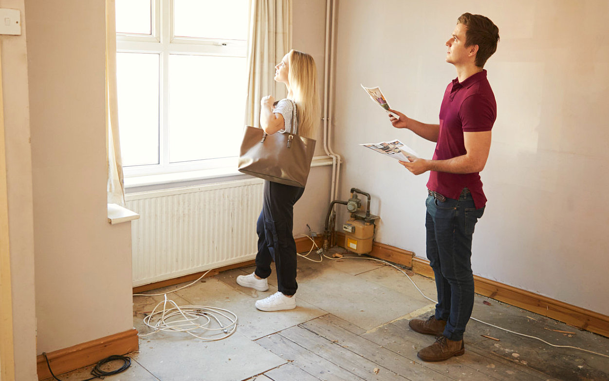 woman checking house with real estate agent